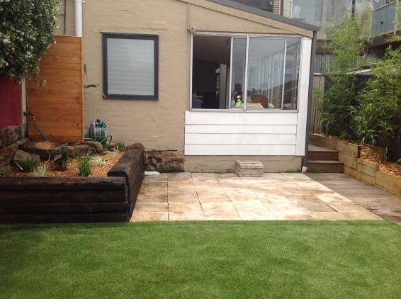 After: wooden screening, Used railway sleeper garden beds, premium astro turf